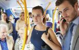 Secretly praying for someone on a bus. Thinkstock.