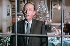 "Bing Crosby sings in a scene from ""White Christmas."""