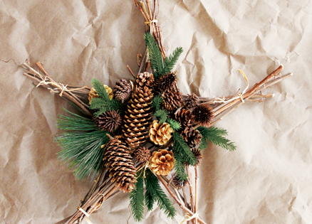 Christmas tree star made from branches and pine cones