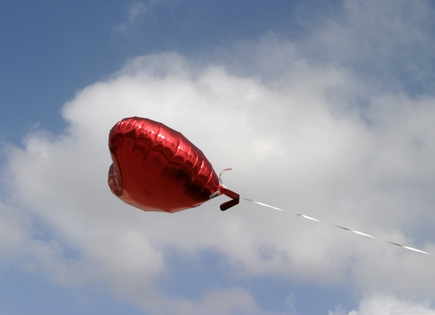a balloon flying in the sky