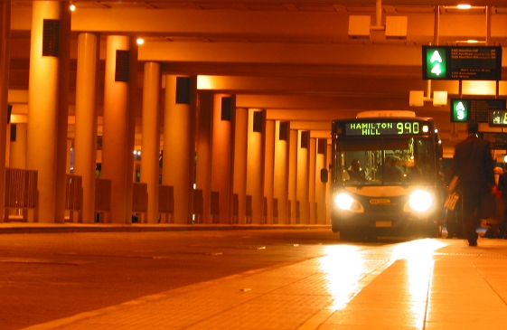 Bus arriving at the station in the middle of the night.