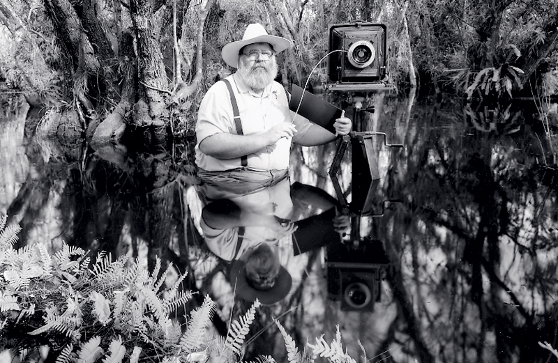 Clyde Butcher with his camera in the Everglades