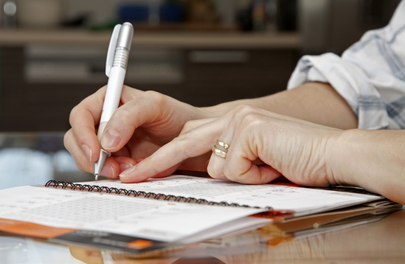 woman writing in her personal calendar