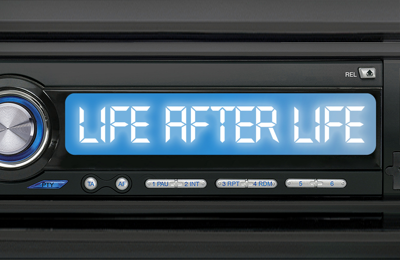 "A car radio dial with the words ""Life After Life"" on it"