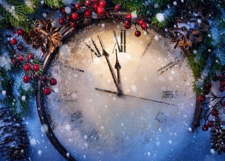 A clock about to strike midnight on New Year's Eve
