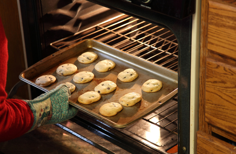 A tray of chocolate chip cookies in the oven