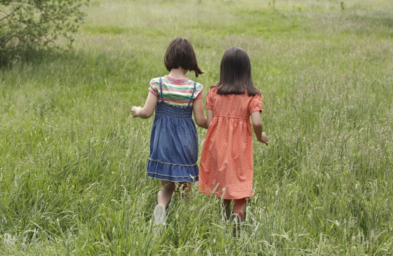 Best girlfriends walking in a field