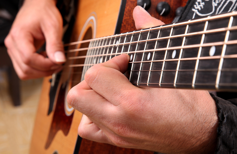 physics of an acoustic guitar essay