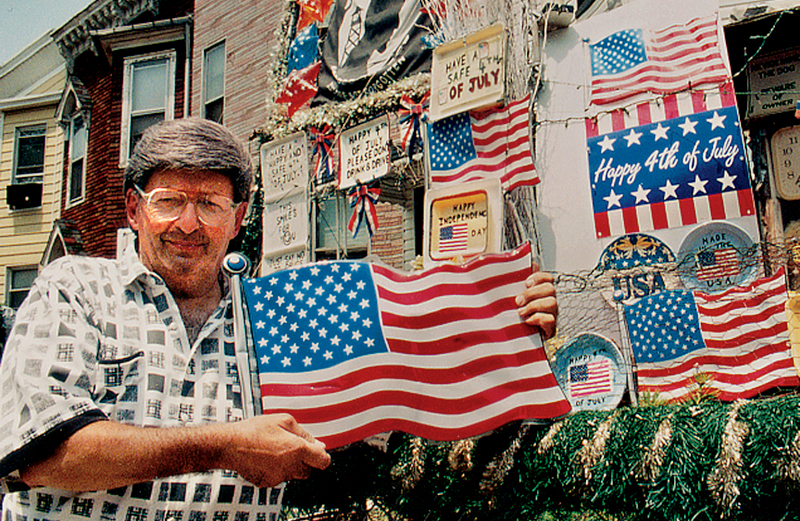 John Zammit poses in front of his house on Fourth of July.