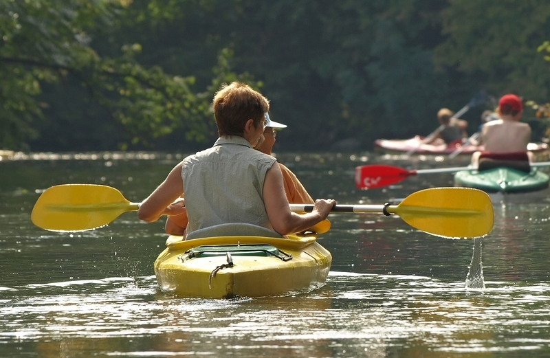 a couple kayaking on a beautiful river