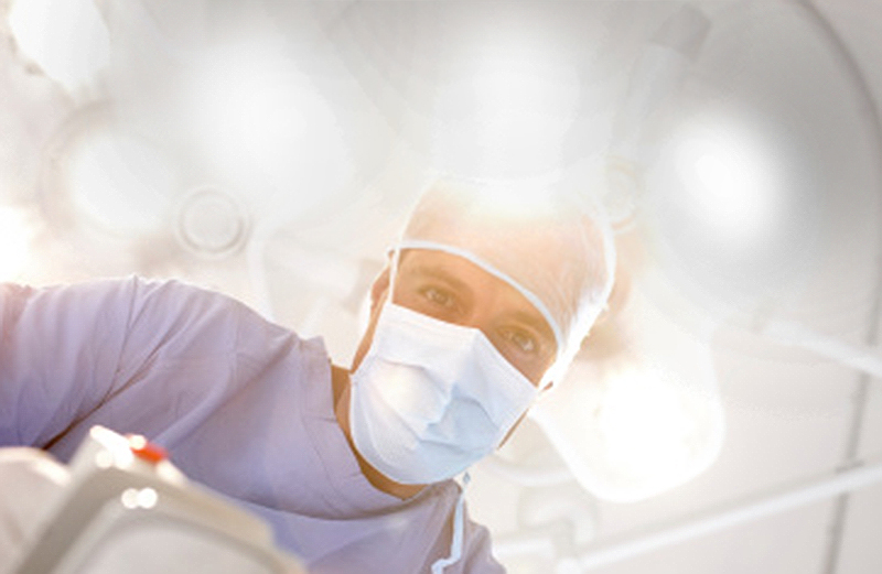 operating room photo with three angelic lights in background