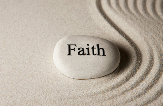 A spirit stone with the word Faith etched in it