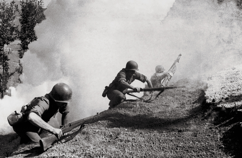 Guideposts: Army Rangers scramble up a hillside during the bloody Italian campaign of 1943.