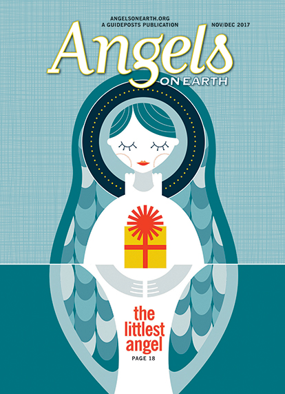 An artist's rendering of a tiny angel with a Christmas gift from the cover of the Nov/Dec 2017 issue of Angels on Earth magazine