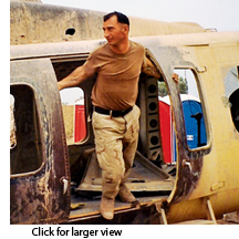 Bobby Heline exiting a helicopter in Iraq