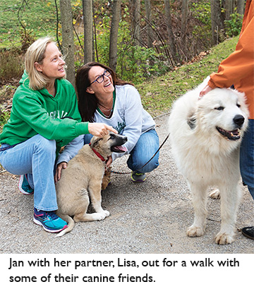Jan with her partner, Lisa, out for a walk with some of their canine friends