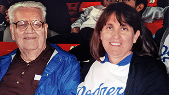 Kathryn Cron with her grandfather at a Dodgers game