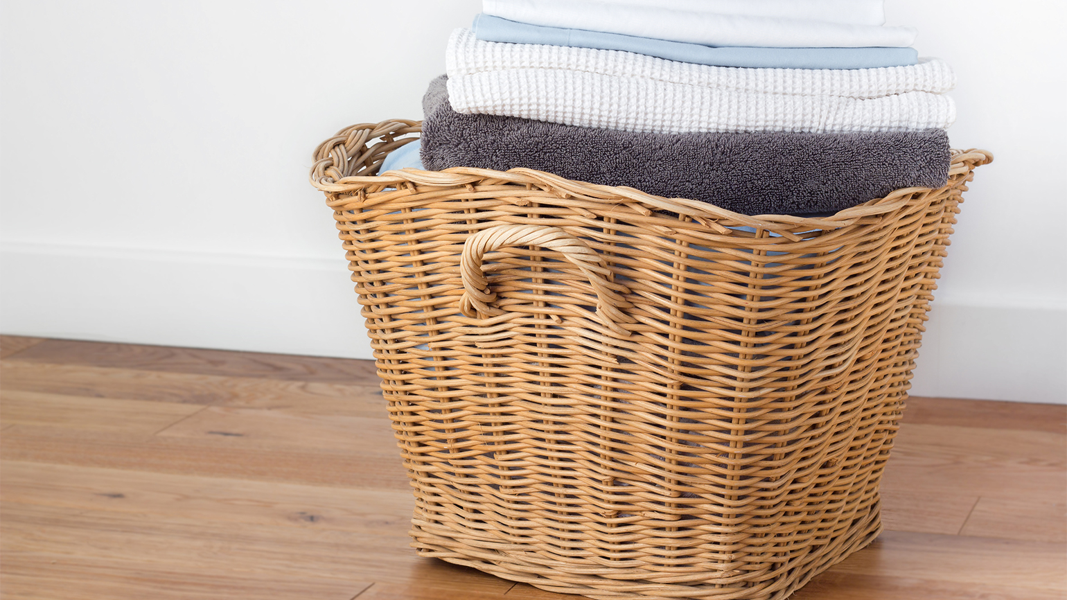 A basket of folded, freshly cleaned laundry