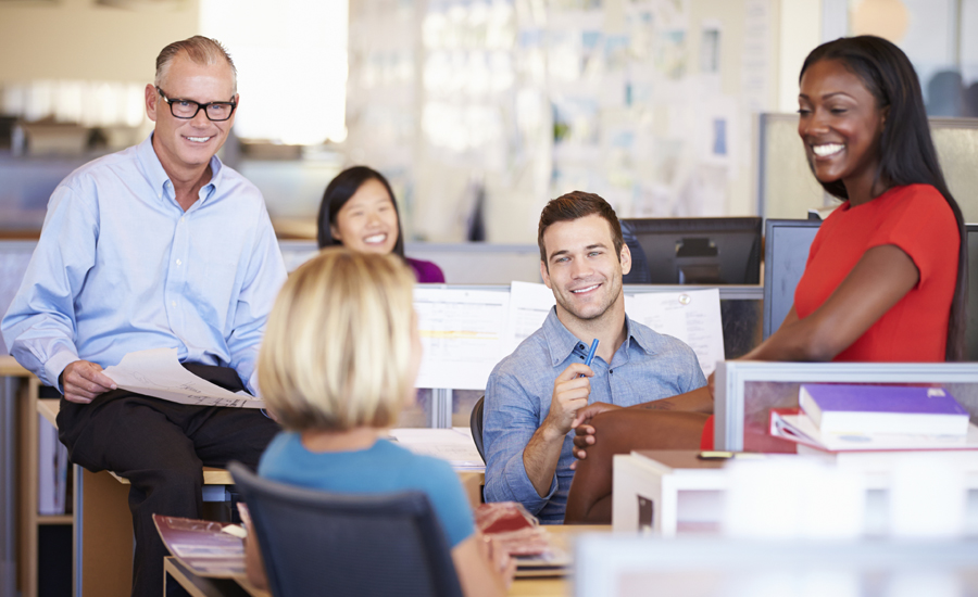 An ethnically diverse group of workers in an office setting