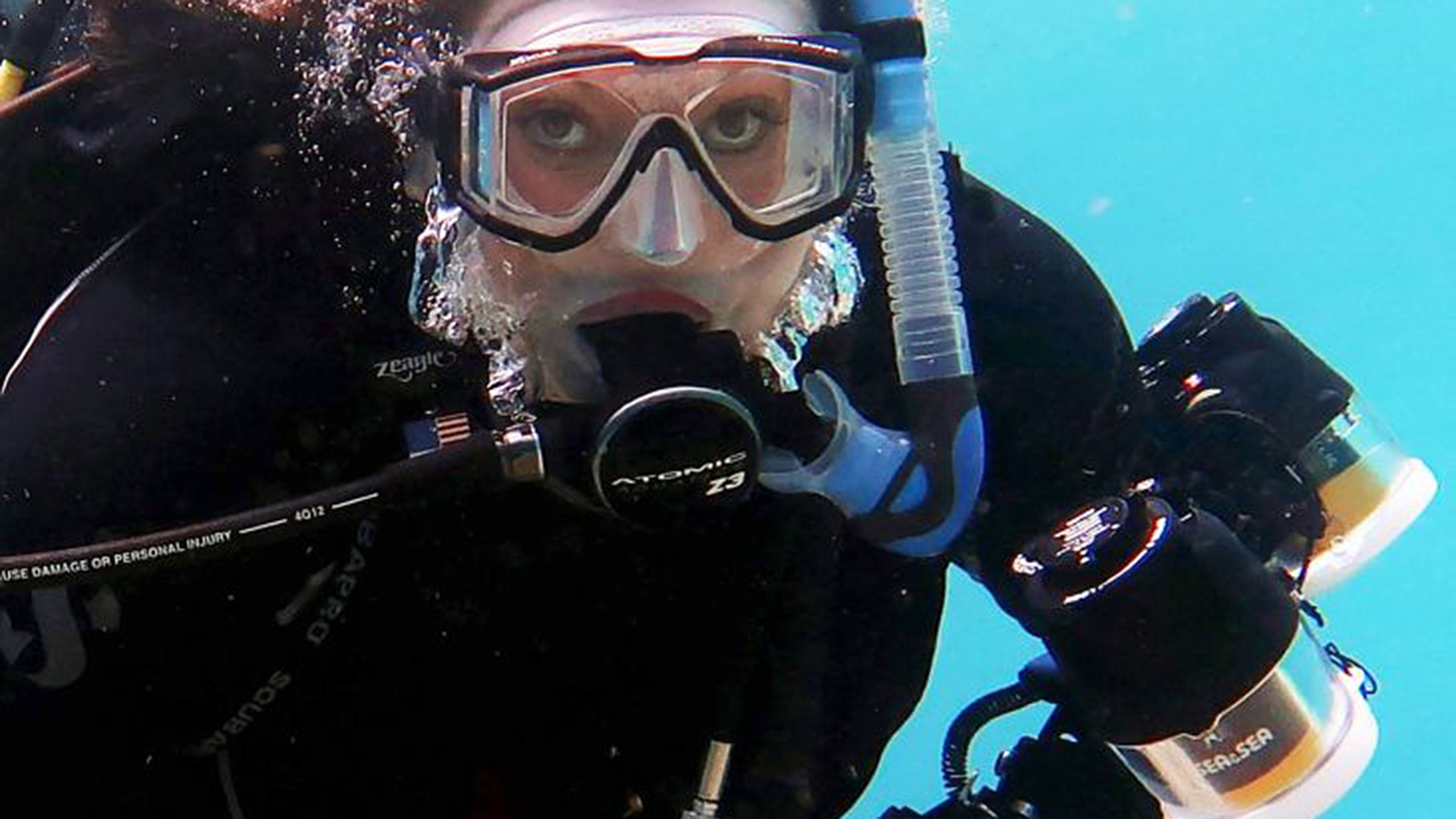 Author and solo world traveler Tam Warner Minton goes scuba-diving