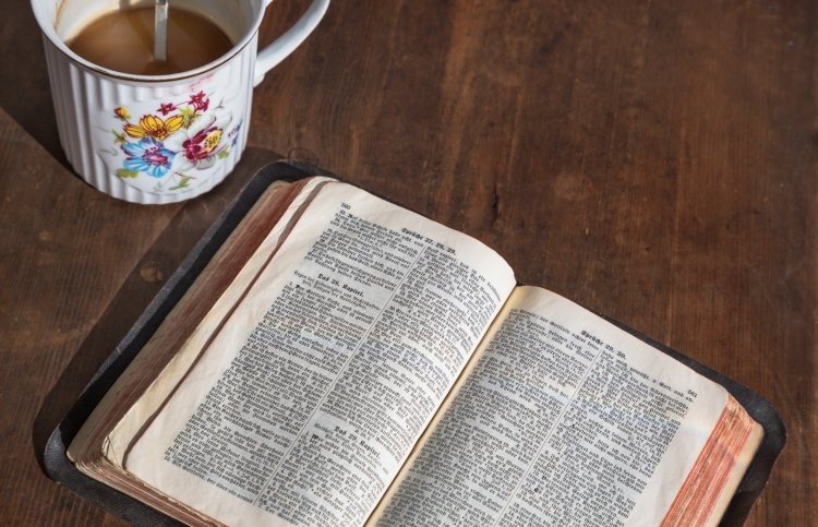 Bible and morning cup of coffee - starting the day with prayer