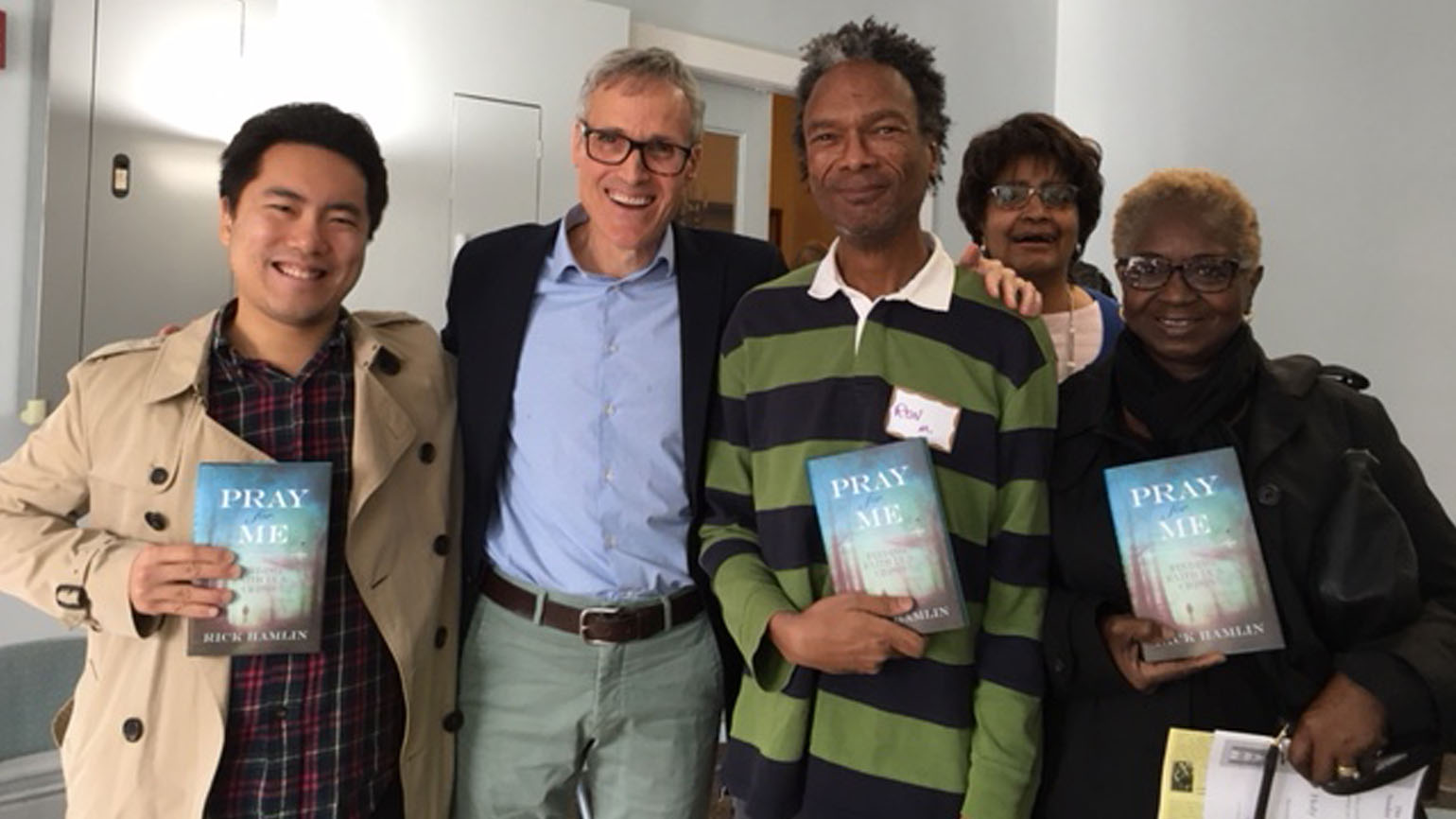 Rick Hamlin with a group of his church friends holding his new book, 'Pray for Me'.