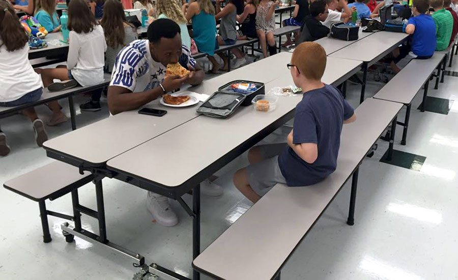 Travis Rudolph lunches with his new friend, Bo Paske