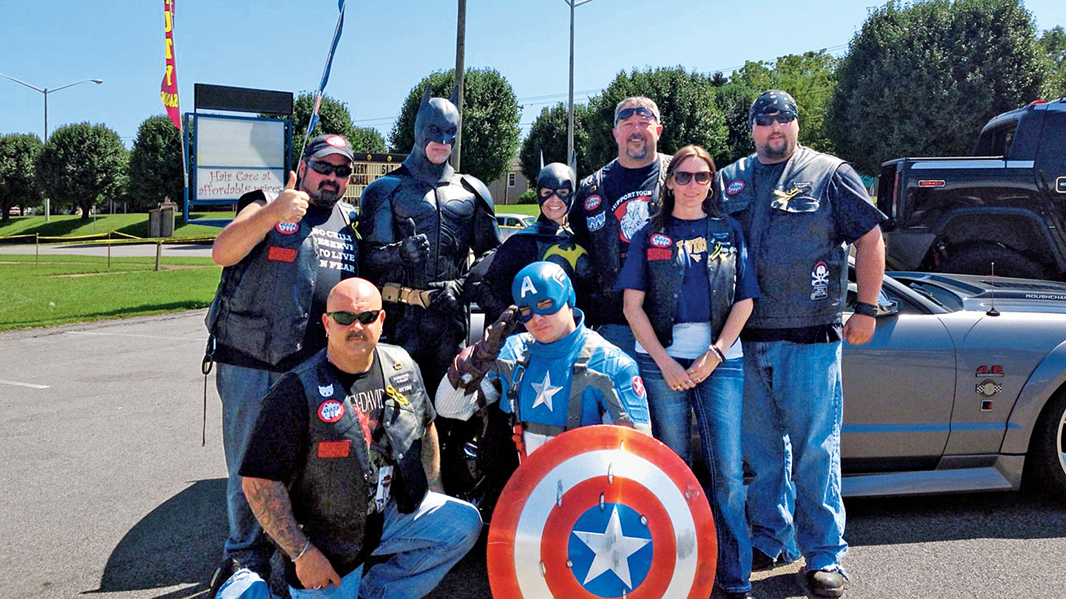 Troy, John and John's wife, Ronda, with Bikers Against Child Abuse