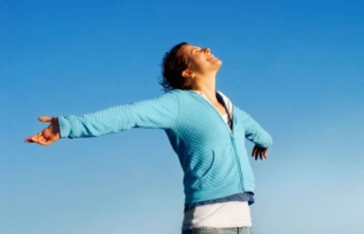 enthusiastic woman with arms outstretched, Guideposts