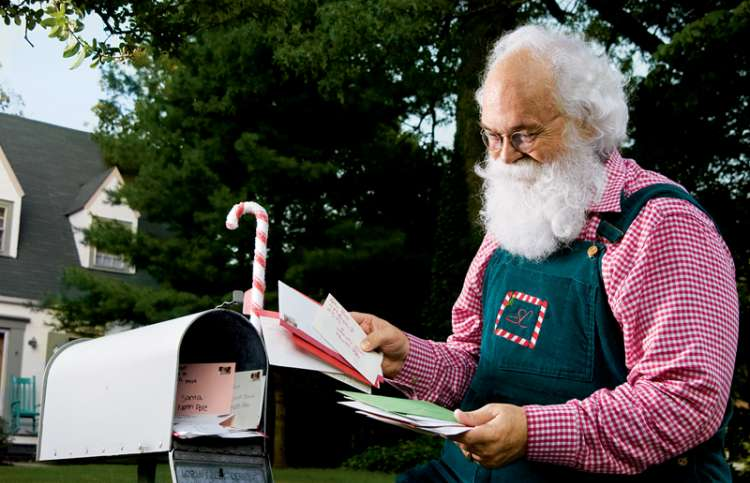 Cliff Snider collects letters from children from his mailbox.