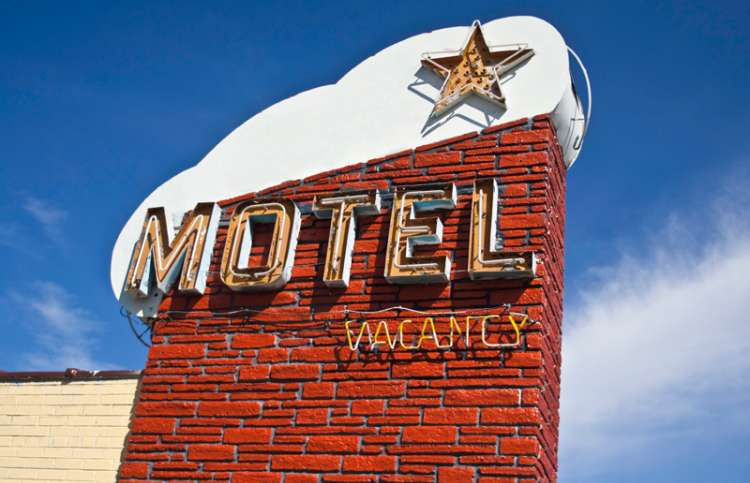 A sign for a roadside motel