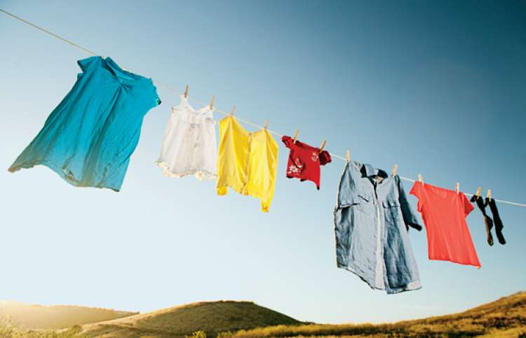 Various articles of clothing drying on a clotheslines