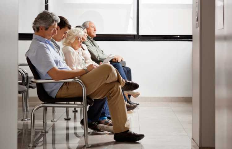 People sitting in a hospital waiting room.
