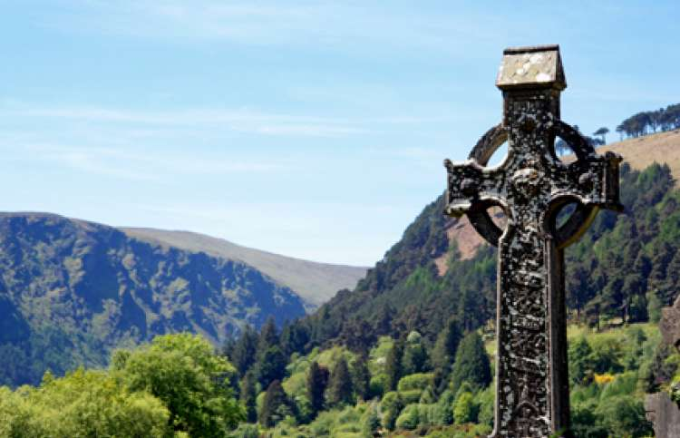 An Irish highcross and a beautiful landscape at Glendalough, County Wicklow
