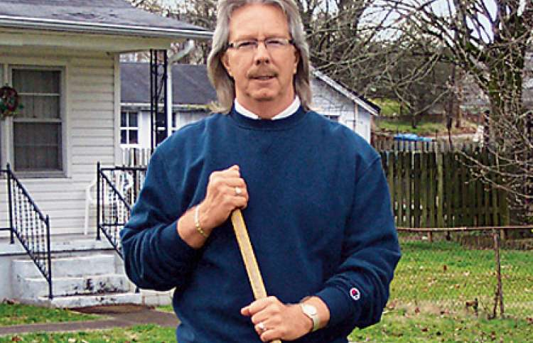 John D. Johnson, rake in hand