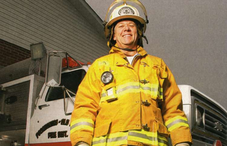 Don Hawley, a father in firefighter's uniform