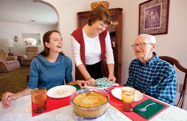 Guideposts: Andrea at the dinner table with her mother and grandfather