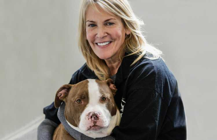 Tricia Montgomery, the founder of K9 Fit Club, with her current dog, Zeus
