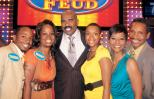 Brandy Rankins (second from left) and her family post with Steve Harvey