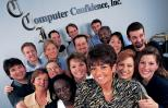 Sally smiles as she poses with a group of her employees.