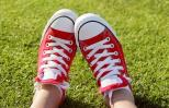 Close-up of feet in a pair of red sneakers