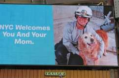 Billboard in Times Square honoring Bretagne the dog and her handler, Denise Corliss. Photo by BarkPost.