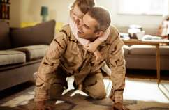Military family enjoying time at home