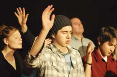 Teens praising God at church