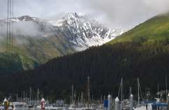 Seward, Alaska harbor with snow-covered mountains