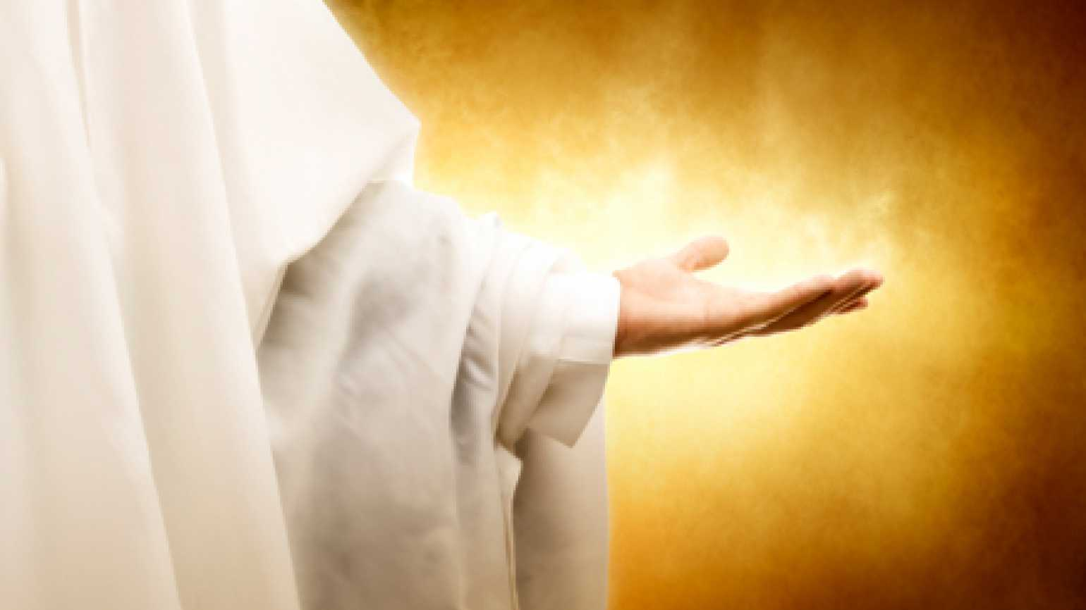 Jesus Christ's outstretched healing hand.