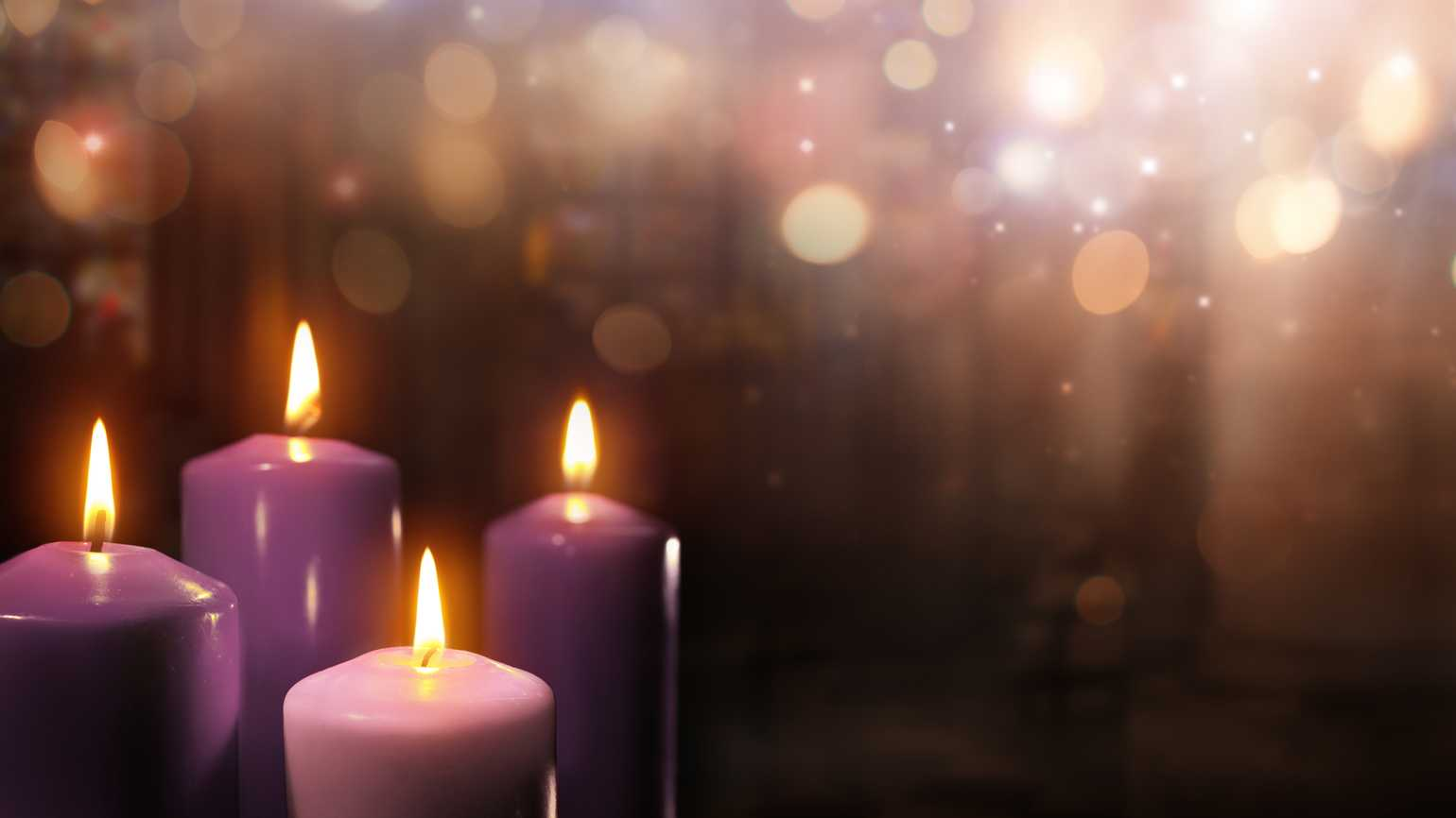 A collection of purple Advent candles in a church.