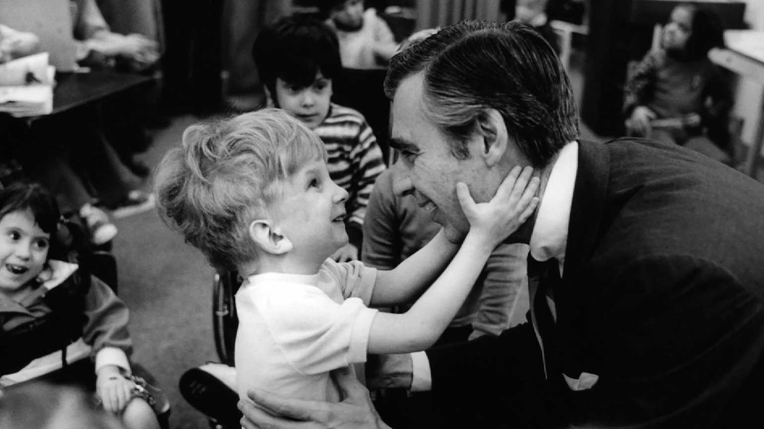 Fred Rogers with a disabled boy on his TV series.
