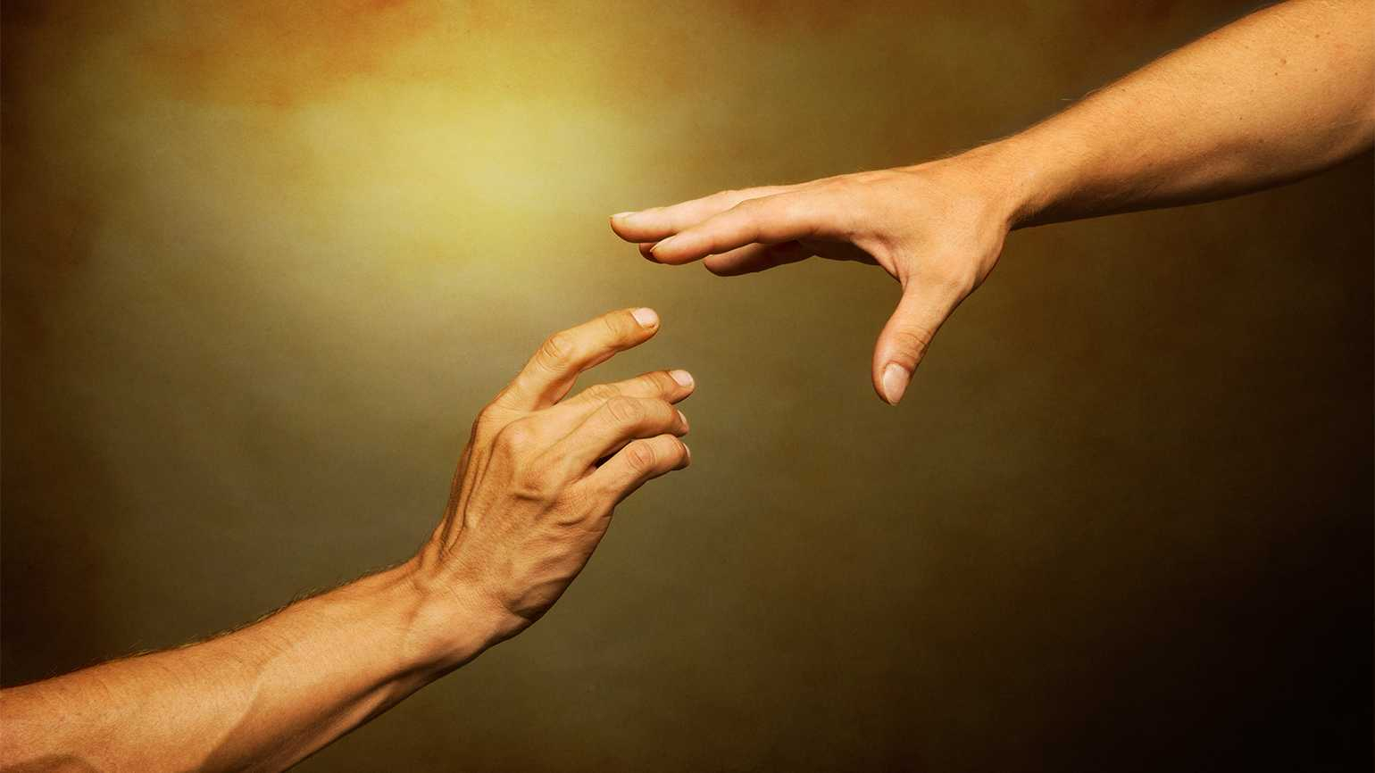 A helping hand outstretched to another