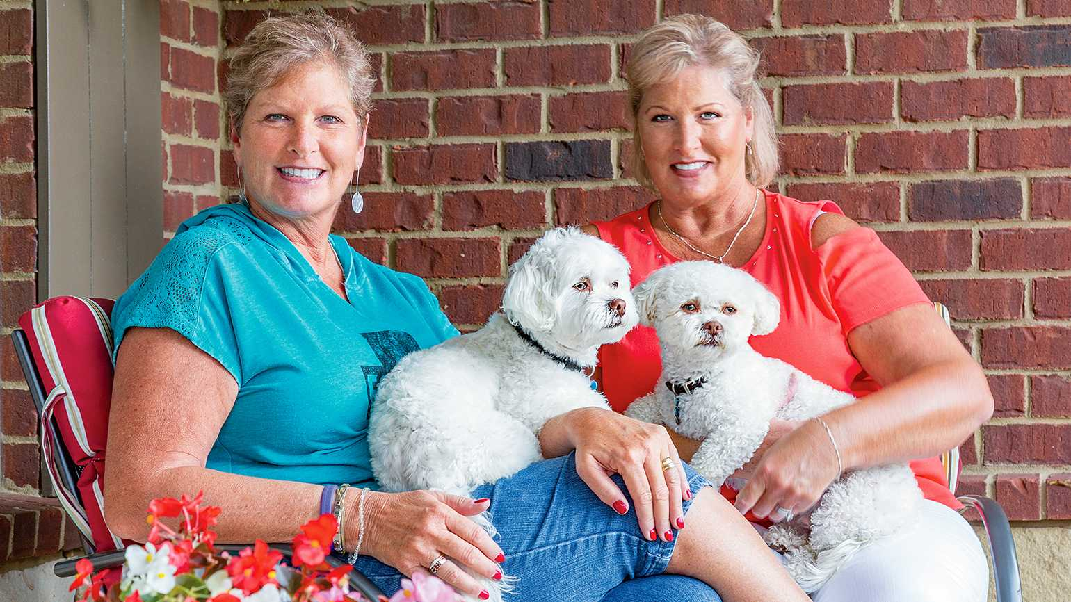 Kim (in red) with her sister, Karen, and their dogs, Cooper and Bentley